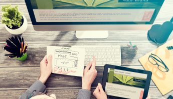 Designer's desk with responsive web design concept.